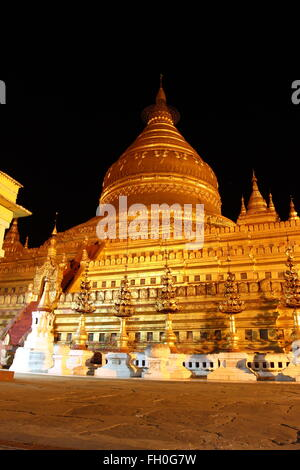 Shwezigon , old Buddhist temples and pagodas in Bagan, Myanmar - Stock Photo