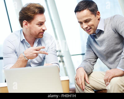 corporate executives discussing business in office. - Stock Photo