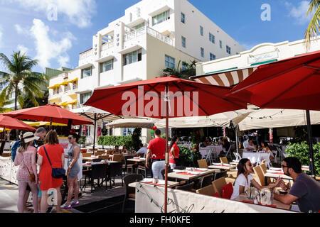 Miami Beach Florida Art Deco District Ocean Drive New Year's Day hotel hotels restaurant alfresco umbrellas tables - Stock Photo
