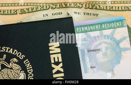 US Permanent  Resident Card with Mexican Passport holder - Stock Photo