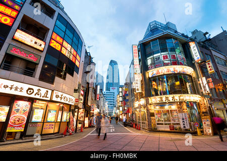 Tokyo; Japan -January 10; 2016: Street view of Nishi Shinjuku Shopping street whith several Japanese Restaurants on the sides.