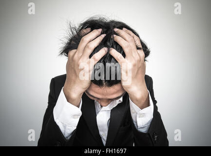 Close-up businessman with burnout syndrome - Stock Photo