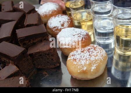 Czech homemade sweet jam doughnuts, brownies, alcohol shots - Stock Photo