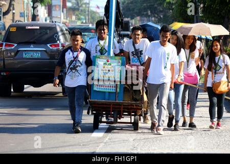 The Dynamic Teen Company (DTC) volunteers while pushing the Kariton Klasrum on their way to Brgy. 5, Alonzo Street, Dalahikan, Cavite City for their weekly community education. The founders of DTC find fulfillment as they slowly grow the number of youths being transformed through their programs. Transformed youth, who used to be drug users, petty thieves, scavengers, street kids, drop-outs and out-of-school youth are now DTC volunteers and have returned to mainstream education. While some of the children remain out of school they, at least, are able to access basic education through K4. (Photo