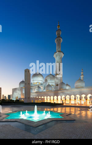Night view of Sheikh Zayed Grand Mosque in Abu Dhabi United Arab Emirates - Stock Photo