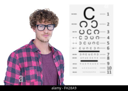 Composite image of handsome man wearing geek glasses over white background - Stock Photo