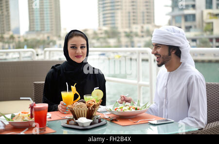Young Emirati arab couple dining - Stock Photo