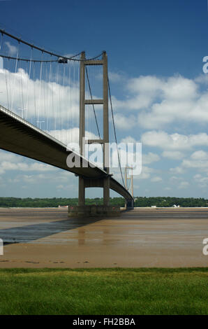 Humber Bridge in portrait format looking North from South bank of the River Humber - Stock Photo