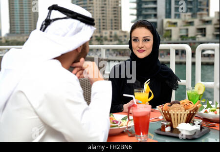 Young Emirati arab couple dining at a restaurant - Stock Photo