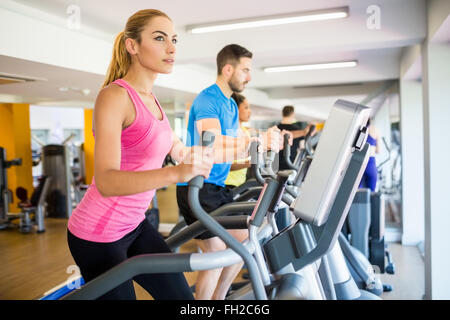 Fit people working out using machines - Stock Photo