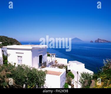 Panarea island, holiday houses, view to vulcano Stromboli , Aeolian Islands, Sicily, Italy, Europe - Stock Photo