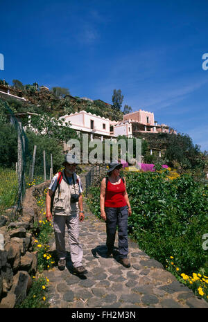 Alicudi island, hiker in Alicudi Porto, Aeolian Islands, Sicily, Italy, Europe - Stock Photo