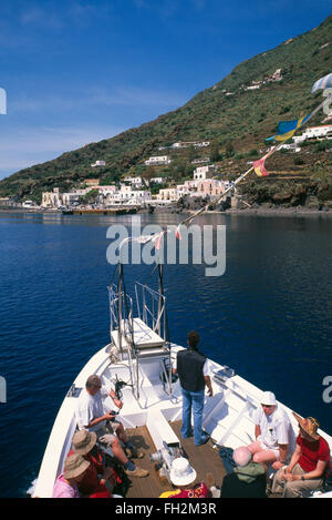 Tourist cruise ship near Alicudi, Aeolian Islands, Sicily, Italy, Europe - Stock Photo