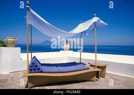 Panarea island, terrace of a holiday houses, view to vulcano Stromboli , Aeolian Islands, Sicily, Italy, Europe - Stock Photo