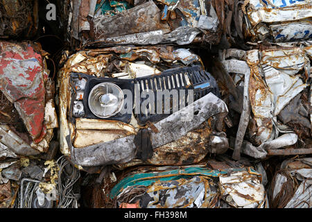 A pile of compressed cars in blocks for processing. - Stock Photo