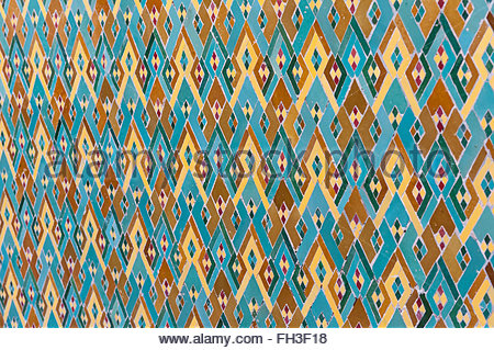 Arabic designs on the wall arranged in colorful patterns. Traditional Islamic colors and shapes. - Stock Photo