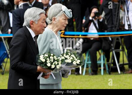 Japanese Emperor Akihito and his wife Empress Michiko pay tribute to the Japanese soldiers at the Japanese Memorial - Stock Photo