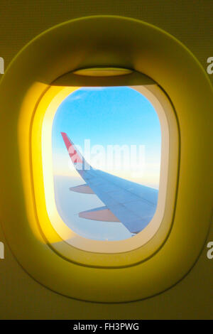 The view from the window on the aircraft wings. - Stock Photo