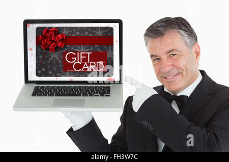 Composite image of gift card with festive bow - Stock Photo