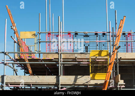 Linden Homes house construction scaffolding and ladders. Hawkswood, Bicester, Oxfordshire, England - Stock Photo