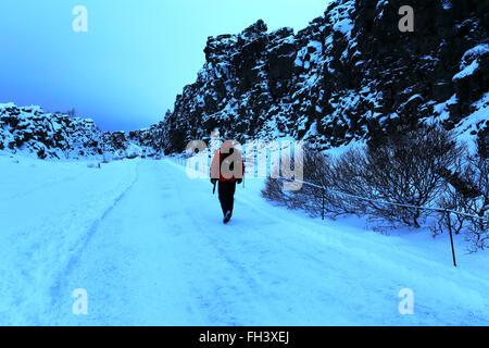 Winter snow, tourists walking at Pingvellir National Park, UNESCO World Heritage Site, South western Iceland, Europe. - Stock Photo