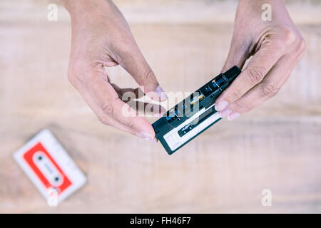 Woman holding old tape - Stock Photo