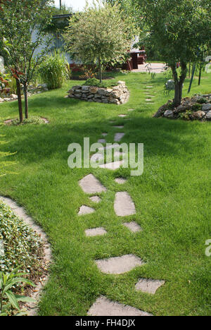 Stone-way in lawn - Stock Photo