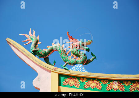 Dragon statue on top of a temple roof - Stock Photo