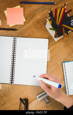 Composite image of businesswomans hand writing with marker - Stock Photo