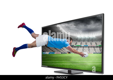 Composite image of rugby player scoring a try - Stock Photo