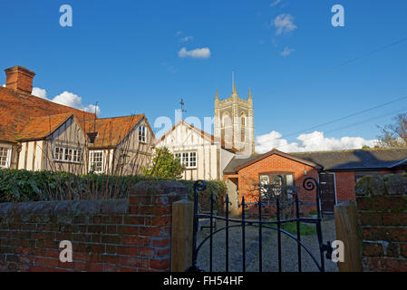 View over rooftops towards the church in the picturesque village of Dedham,UK made famous by artist John Constable. - Stock Photo