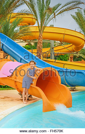Girl Slides Into A Swimming Pool With A Splash Stock Photo Royalty Free Image 54131506 Alamy