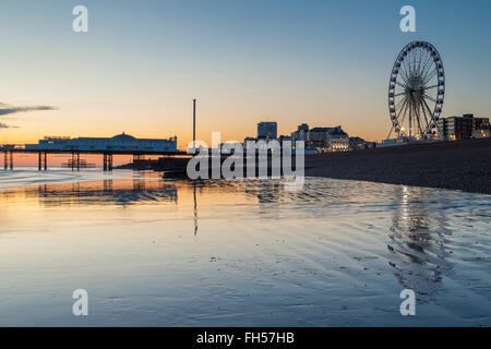 Sunset on Brighton beach, East Sussex, England. - Stock Photo
