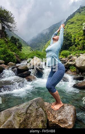 sporty fit woman doing surya namaskar ashtanga vinyasa