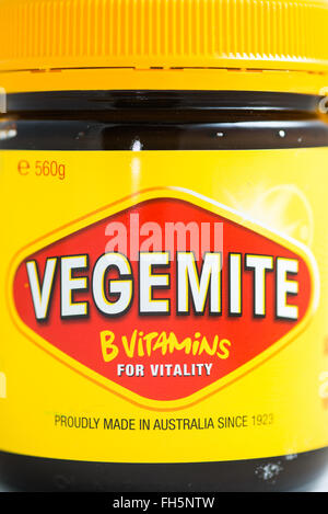 Vegemite is a dark brown Australian food paste made from brewers' yeast extract with various vegetable and spice - Stock Photo