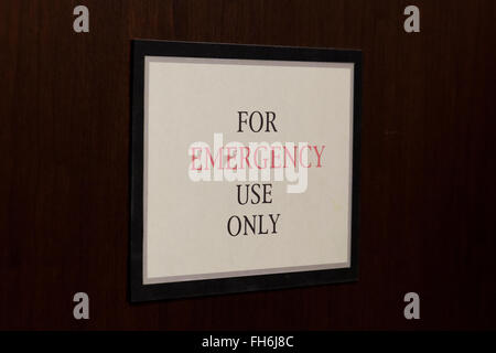 For Emergency Use Only sign on door - USA - Stock Photo