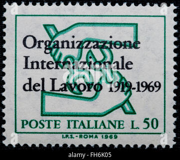 1969 - Italian mint stamp issued to commemorate International Work Organization Lire 50 - Stock Photo