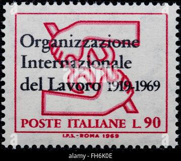 1969 - Italian mint stamp issued to commemorate International Work Organization Lire 90 - Stock Photo
