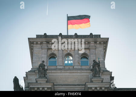 Germany, Berlin, German flag on Reichstag - Stock Photo