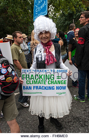 Anti-Fracking woman with sign in Marie Antoinette wig and tutu, Climate Change March, NYC  Sept.21, 2014 - Stock Photo