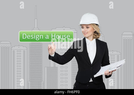 Business woman pressing desing a hause button on virtual screens. Residential Blocks. Business, technology, internet - Stock Photo