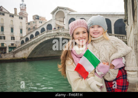 Modern family taking a winter break to enjoy inspirational adventure in Venice, Italy. Happy mother and daughter - Stock Photo