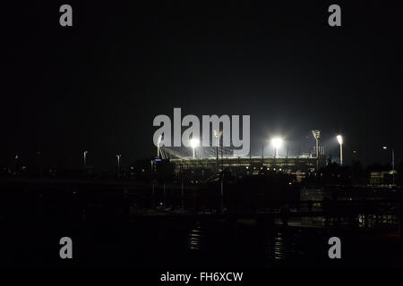 Melbourne, Australia - April 24, 2015: Melbourne Cricket Ground by night illuminated for a match. - Stock Photo
