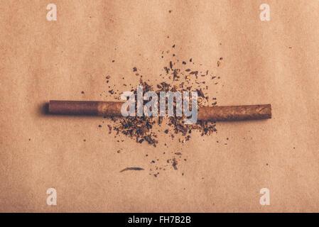 Quit smoking concept, broken cigarette top view, warm retro image tone. - Stock Photo