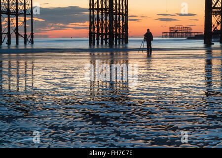Evening on Brighton beach at low tide, UK. - Stock Photo