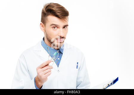 Handsome male doctor looking at camera isolated on a white background - Stock Photo