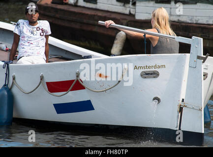 Small boat in Amsterdam. Holland - Stock Photo