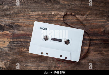 Music white tape on a wooden background - Stock Photo