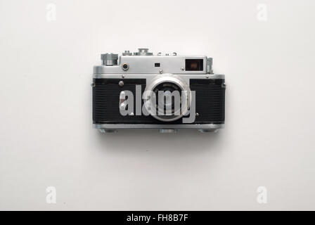 Old rangefinder vintage camera on white background - Stock Photo