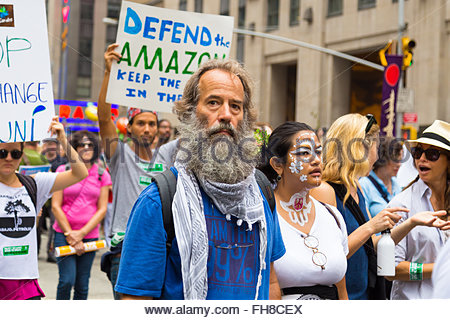 New York, USA - 21 September 2014:  Bearded man marches and campaigns for greater environmental awareness during - Stock Photo
